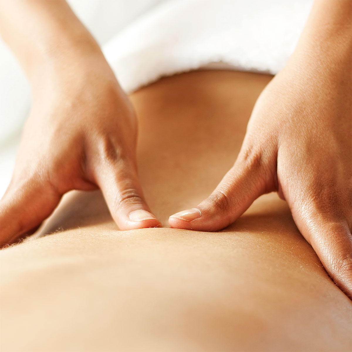 Calgary Registered Massage Therapists giving deep tissue massage for sports injury